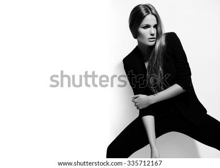 High fashion look.glamor beautiful sexy hot stylish Caucasian young brunette woman model in black hipster clothes posing near white wall - stock photo