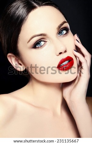 High fashion look.glamor closeup beauty portrait of beautiful   Caucasian young woman model with bright makeup   with perfect clean skin with colorful red lips - stock photo