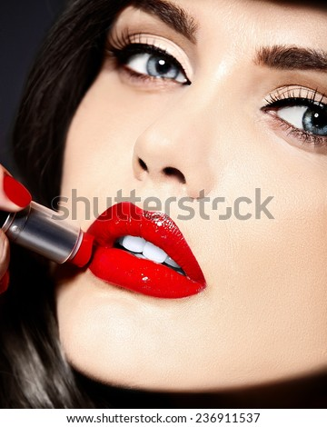 High fashion look.glamor closeup beauty portrait of beautiful Caucasian young woman model with bright makeup with perfect clean skin with colorful red lips and lipstick - stock photo