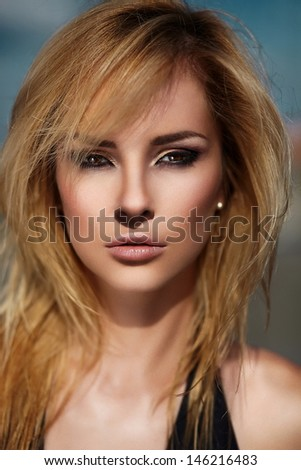 High fashion look.glamor closeup portrait of beautiful sexy stylish blond Caucasian young woman model with bright makeup, with perfect sunbathed clean skin outdoors  - stock photo