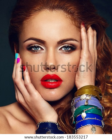 High fashion look.glamor closeup portrait of beautiful sexy stylish Caucasian young woman model with bright makeup, with red lips,  with perfect clean skin with colorful nails - stock photo