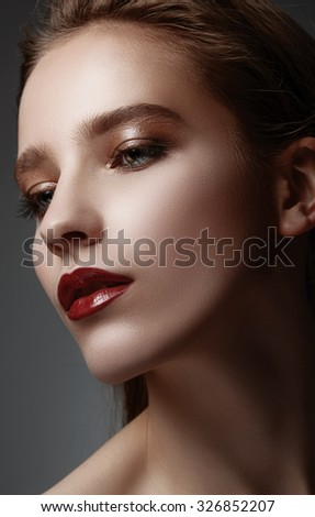 High fashion look. Glamor closeup portrait of beautiful sexy stylish caucasian young woman model with bright makeup, with red lips, with perfect clean skin - stock photo