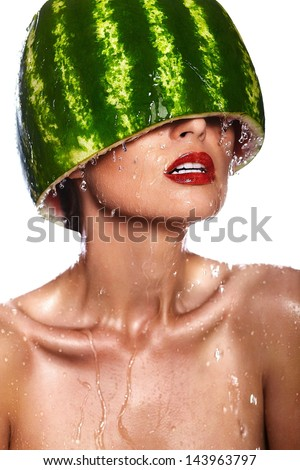 High fashion look.glamor closeup portrait of beautiful sexy young woman model with water-melon on head with water drops with red lips, with perfect wet clean skin - stock photo