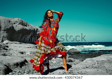 High fashion look.glamor sexy Caucasian model girl in black swimweari posing behind blue beach ocean water in vogue style in sunglasses - stock photo
