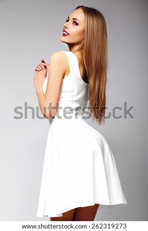 High fashion look.glamor sexy stylish blond smiling young woman model with bright makeup with perfect sunbathed clean skin in white summer dress with red lips - stock photo