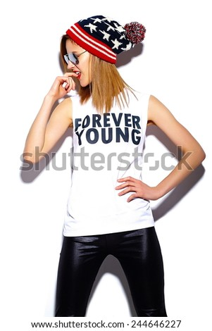 High fashion look.glamor stylish beautiful  young woman model with red lips  in hipster cloth in sunglasses in colorful beanie - stock photo