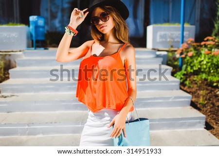 High fashion look.glamor stylish beautiful young woman model with red lips in summer bright colorful hipster cloth,jewelry,trendy accessory,design dress collection,Shopping time,stairs,black hat,urban - stock photo