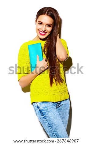 High fashion look.glamor stylish sexy smiling beautiful young woman model in summer bright yellow casual  hipster cloth with clutch  purse - stock photo
