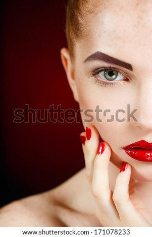 High fashion look.glamour fashion portrait of beautiful sexy brunette girl female model with bright makeup and red lips on dark with perfect skin - stock photo