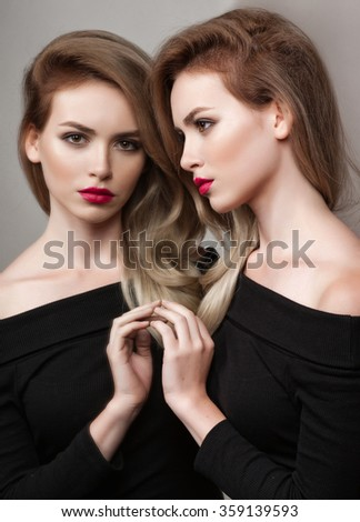 High fashion look.glamour fashion portrait of beautiful sexy brunette girl female model with bright makeup and red lips and her reflection in mirror - stock photo