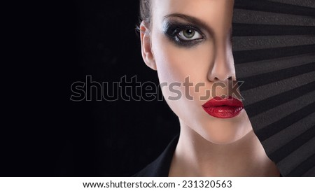 High fashion look.glamour portrait of beautiful sexy young female woman with red lips on black background  - stock photo