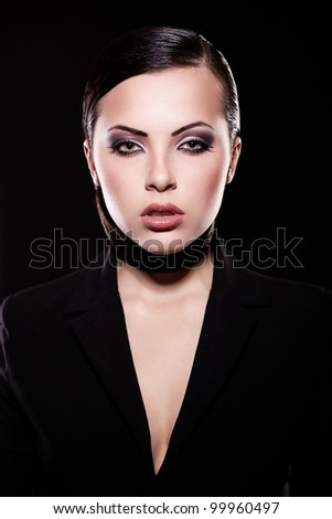 High fashion look. portrait of beautiful brunette girl model in black jacket  with bright makeup and juicy lips. Clean skin. Isolated on black - stock photo