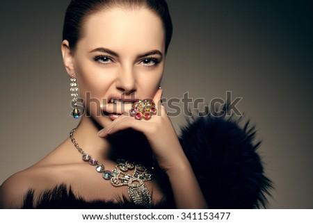 High-fashion Model Beauty Woman precious jewelry Perfect skin lips passion aggression - stock photo