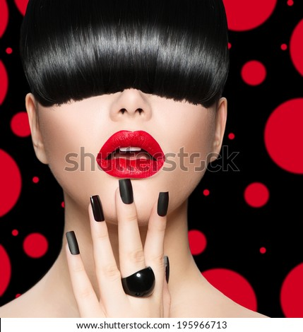 High Fashion Model Girl Portrait with Trendy Hair style, Make up and Manicure. Long Black Fringe Hairstyle, Black Matte Nail Polish and Red Matte Lipstick. Woman Makeup. Sexy Lips. Haircut - stock photo