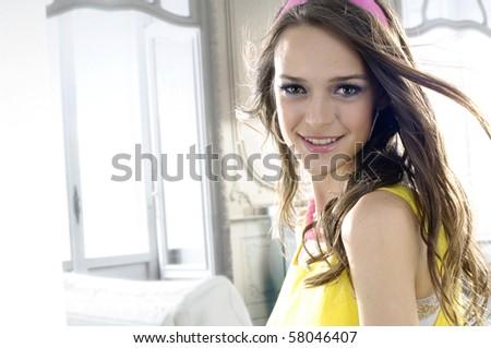 High fashion model in modern dress posing in the studio - stock photo