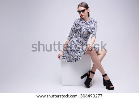 high fashion portrait of young elegant woman. Studio shot  - stock photo