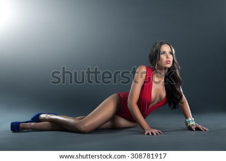 High fashion shot of attractive woman in single piece red lingerie - stock photo
