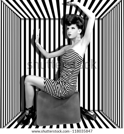 High Fashion Woman With Stripes Boxed - stock photo