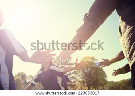 High Five line after a child's soccer game.  Instagram effect - stock photo