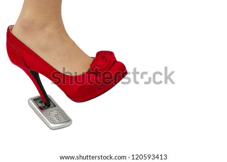 high heel kicking through cellphone - stock photo