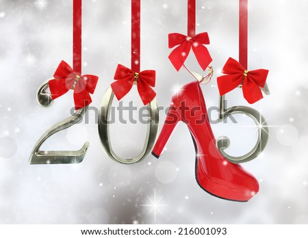 High heel shoe and 2015 number hanging on red ribbons in a glittery background - stock photo