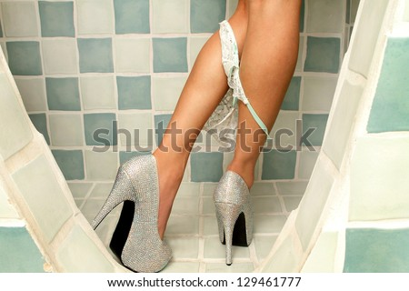 High heels and underwear of latina woman undressing - stock photo