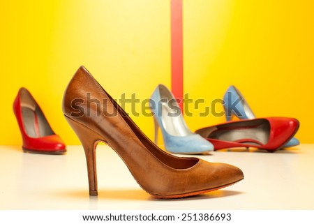 high heels shoes on colored background - stock photo