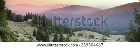 High in the mountains located Gutsulschiny tract with ancient Christian monastery, where the summer praying shepherds of sheep, cows and horses, and there is no one in the fall - stock photo