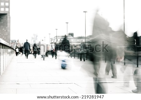 High key, abstract captures of business commuters during early morning London rush hour.  Long exposure creating a motion blur to emulate the movement of the scene. - stock photo