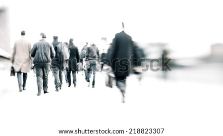 High key, abstract captures of business commuters during early morning London rush hour.  Tilt-shift, long exposure creating a motion blur to emulate the movement of the scene. - stock photo
