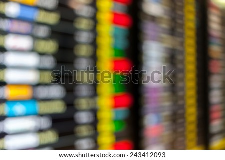 High key blurred image of Departure and arrivals electronic schedule board in airport. - stock photo