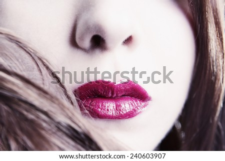 High Key Close-up Of Woman's Face With Vibrant Red Lipstick - stock photo