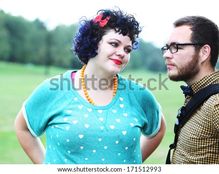 High key image of attractive young couple in Prospect Park, Brooklyn with grass & trees in background - stock photo