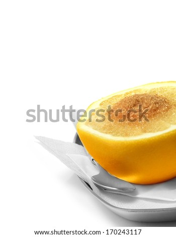 High key image of fresh yellow grapefruit sprinkled with natural demerara sugar against a white background. The perfect image for a breakfast menu, Copy space. - stock photo