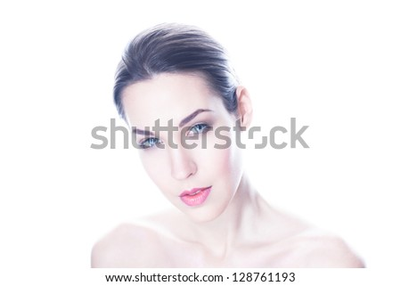 High key portrait of beautiful woman on white background - stock photo