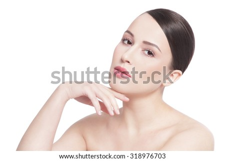 High key portrait of young beautiful healthy happy woman touching her face and looking upwards over white background, copy space - stock photo
