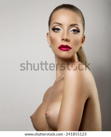 High key portrait of young beautiful woman on white back - stock photo