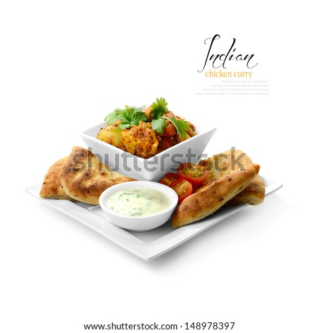 High key studio shot of freshly prepared Indian chicken curry dish. Selectively lit to create soft shadows color corrected to create a black and white background. Copy space. - stock photo