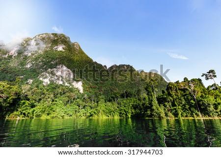 High mountain and blue sky over lagoon at Kho Sok , Thailand - stock photo