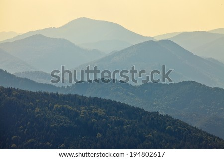 High mountain landscape in hazy weather, soft natural background. - stock photo