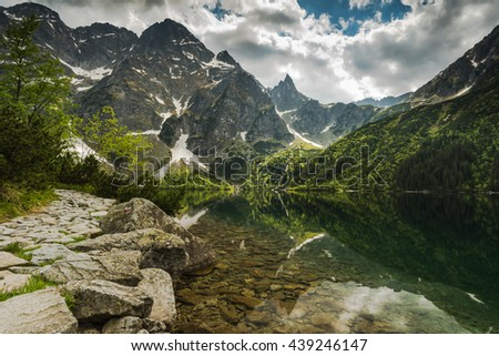 High mountains reflect in Morskie Oko Lake in Polish Tatra National Park - stock photo