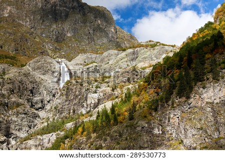 High picuresque waterfall in Ushba walley in Caucasus mountains in Georgia - stock photo