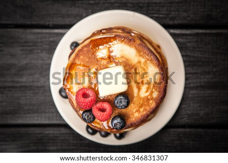 High pile of delicious pancakes with blueberry - stock photo