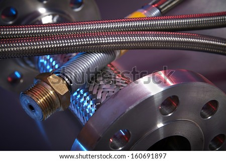 High Pressure Hoses on Stainless Steel Background - stock photo