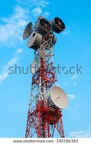 High radio antenna. On a sky background. - stock photo
