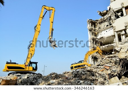 high reach demolition excavator - stock photo