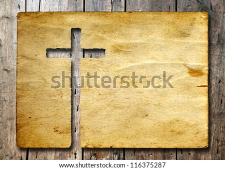 High resolution christian cross cut in an old grungy or vintage paper, over a wood background, ideal for religion, Christian, grunge or conceptual designs - stock photo