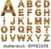 High resolution conceptual golden fonts set or collection isolated on white background, made of yellow metal similar to gold ideal for vintage,grungy,technology or holiday designs - stock photo