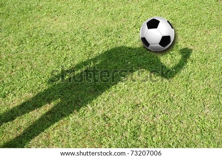 High resolution 3D soccer ball placed on the head of a human shadow, in green grass background - stock photo