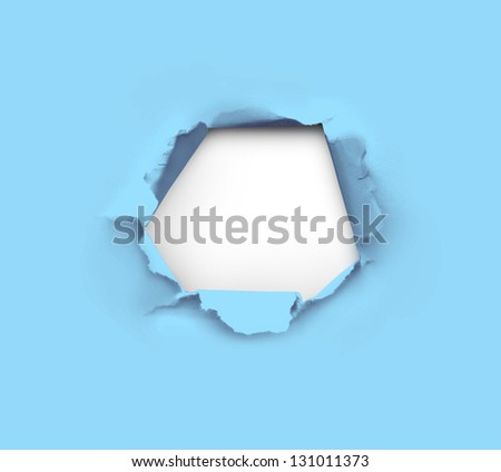 high resolution hole in blue paper - stock photo